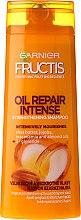 Kup Intensywnie regenerujący szampon do włosów - Garnier Fructis Oil Repair Intense Strenghtening Shampoo