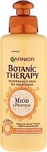 Kup Regenerujący krem bez spłukiwania do włosów bardzo zniszczonych z rozdwojonymi końcówkami Miód i propolis - Garnier Botanic Therapy Honey & Propolis Leave-In Cream-Oil