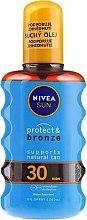 Olejek przeciwsłoneczny aktywujący opaleniznę SPF 30 - Nivea Sun Care Protect And Bronze Oil — фото N1