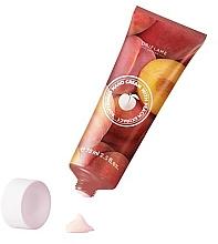 Kup Zmiękczający krem do rąk z ekstraktem z brzoskwini - Oriflame Hand Cream With Peach Extract
