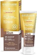 Kup Barierowy krem ochronny do twarzy SPF50 - Farmona Nivelazione Sun Creme Facial