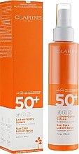 Kup Przeciwsłoneczny balsam w sprayu do ciała SPF 50+ - Clarins Sun Care Lotion Spray