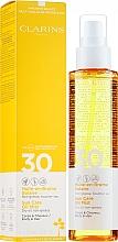 Kup Przeciwsłoneczny suchy olejek w mgiełce do ciała i włosów SPF 30 - Clarins Sun Care Oil Mist