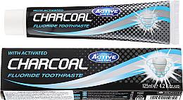 Kup PRZECENA! Pasta do zębów z węglem aktywnym - Beauty Formulas Charcoal Activated Fluoride Toothpaste *